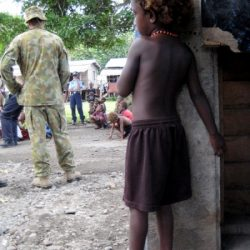 solomon islands child watching army